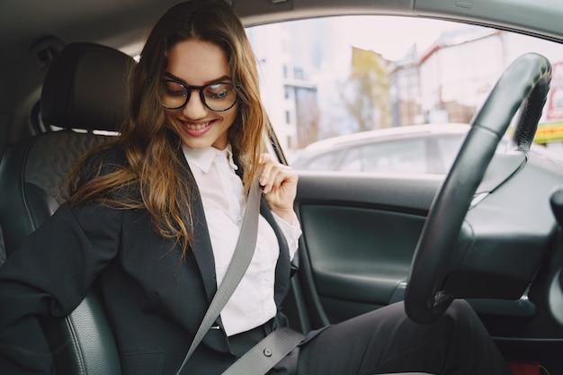 Businesswoman sitting inside a car Free Photo