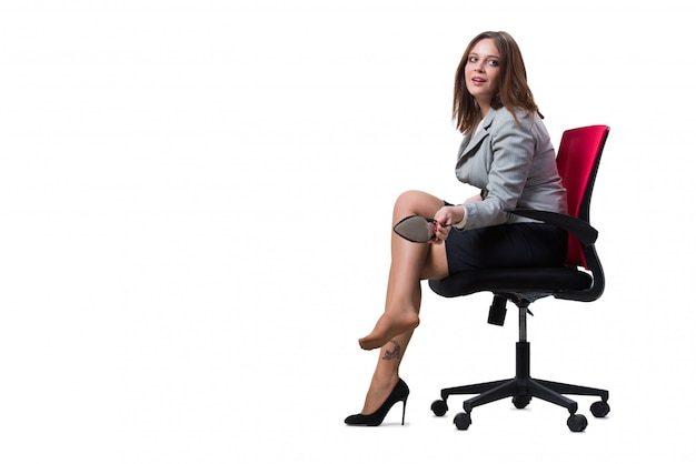Businesswoman sitting isolated on white Premium Photo