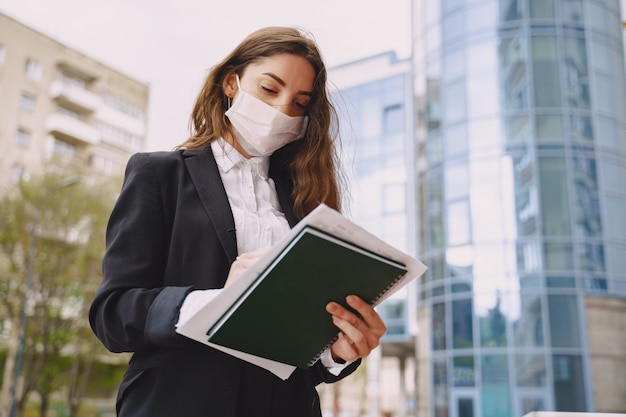 Businesswoman standing outdoors in city office building Free Photo