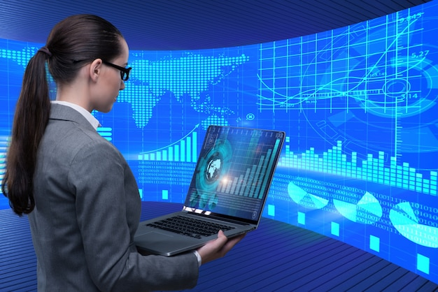 Businesswoman in stock exchange trading concept Premium Photo
