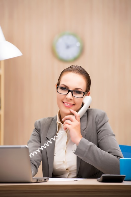 Businesswoman under stress from too much work in the office Premium Photo
