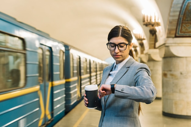 Businesswoman in subway station Free Photo