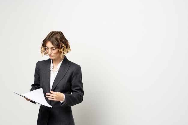 Businesswoman in a suit with documents Premium Photo