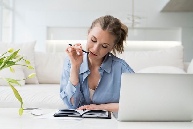 Businesswoman thinking at desk Free Photo