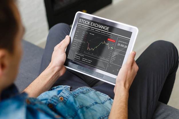 Businesswoman trading stocks with tablet and graph Premium Photo