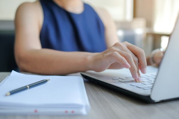 Businesswoman using laptop for analysis maketing plan Premium Photo