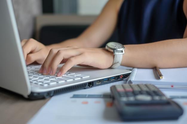 Businesswoman using laptop for analysis maketing plan Premium Photo