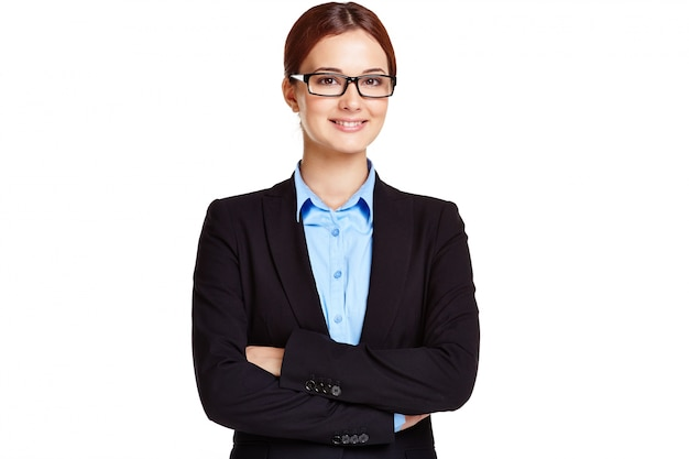 Businesswoman with glasses and crossed arms Free Photo
