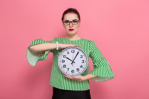 Businesswoman with hair bun and clocks Premium Photo
