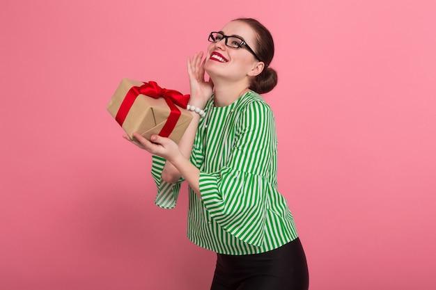 Businesswoman with hair bun and present Premium Photo