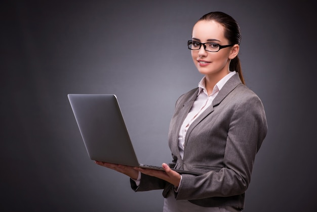 Businesswoman with laptop in business concept Premium Photo