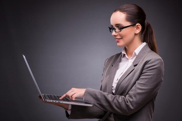 Businesswoman with laptop Premium Photo