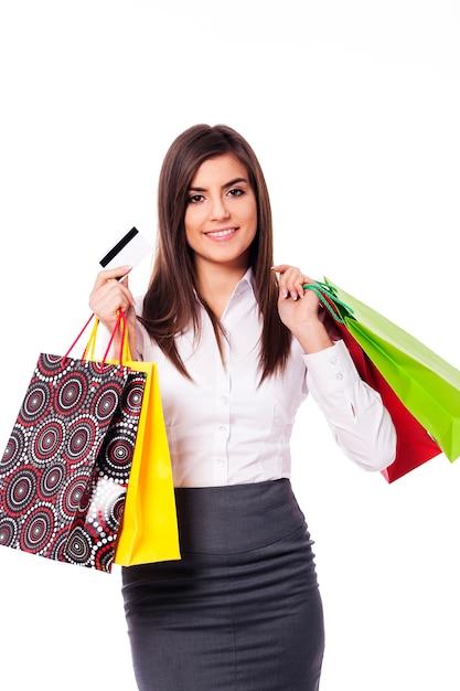 ショッピングバッグとクレジットカードを持つ実業家 無料写真
