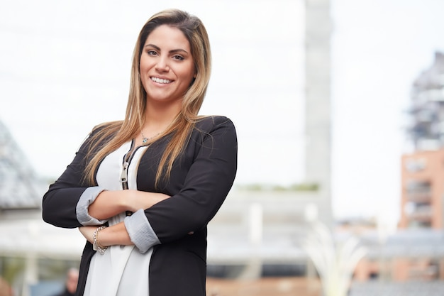 Businesswoman working outside office building Premium Photo
