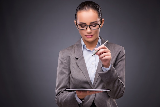 Businesswoman working on tablet computer in business concept Premium Photo