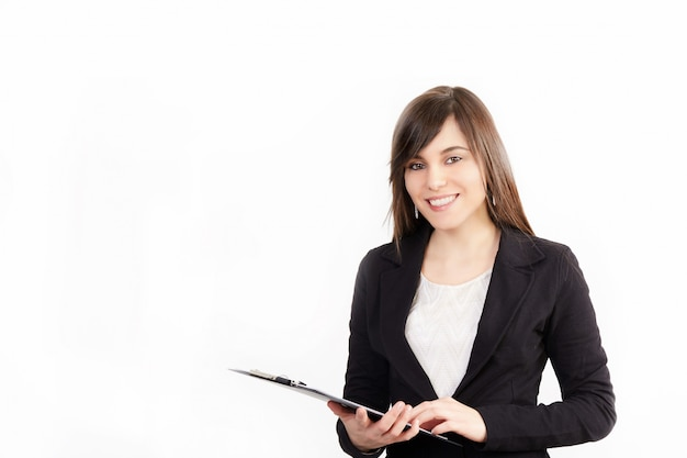 Businesswoman working with clipboard - studio background Premium Photo