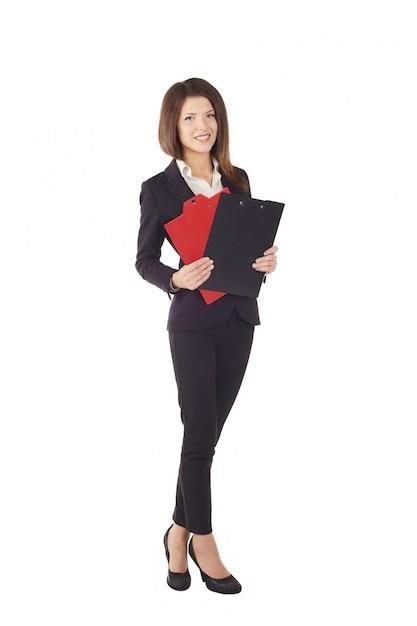 Businesswoman working with clipboard - studio background Premium Photo
