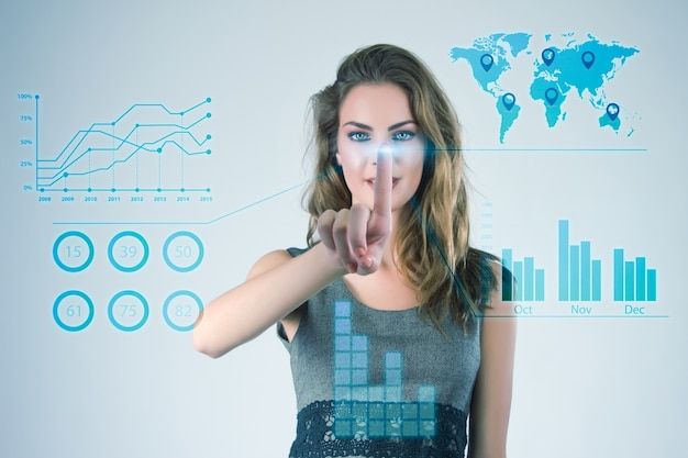 Businesswoman working with modern virtual technologies hands touching the screen. Free Photo
