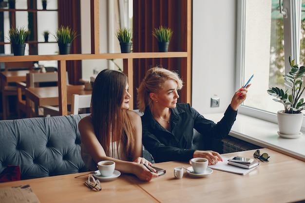 Businesswomen in a caffe Free Photo