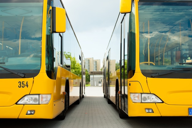 Busses parking in row on bus station or terminal Premium Photo