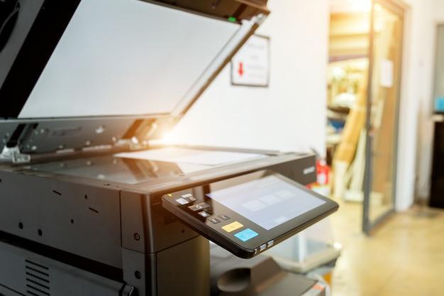 Bussiness man hand press button on panel of printer Premium Photo