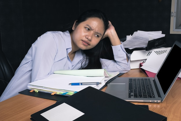 Bussiness woman feeling tired during work at the office Premium Photo