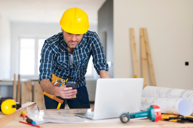 Busy building contractor at work Free Photo