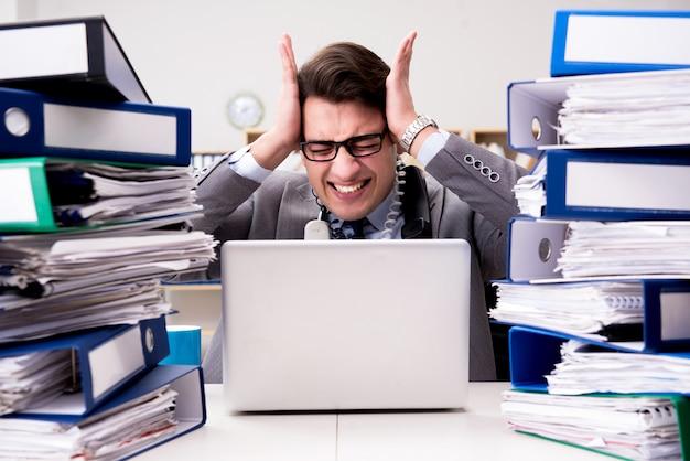 Busy businessman under stress due to excessive work Premium Photo