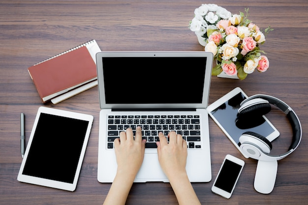 Busy businesswoman with digital devices Free Photo