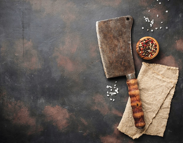 Butchers vintage cleaver with spices Premium Photo