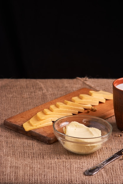 Butter and cheese and milk for breakfast, over rustic wood Premium Photo