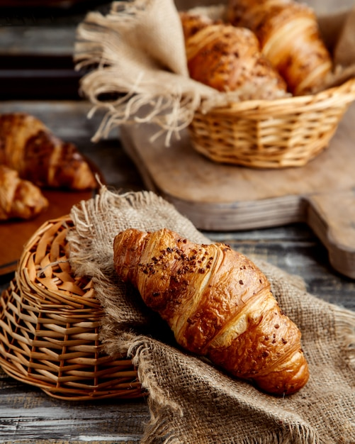 Butter croissant placed on linen fabric Free Photo