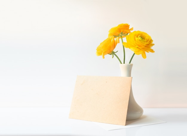 Buttercup flowers in vase. Free Photo