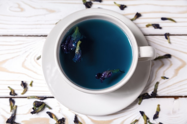 Butterfly pea blue flower tea in a white cup. healthy detox herbal drink. butterfly peas blue tea anchan in a cup top view Premium Photo