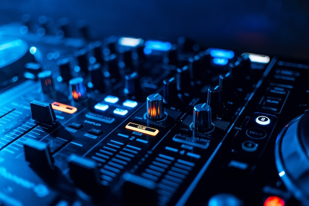 Buttons and volume levels and mixing music on professional board dj Premium Photo