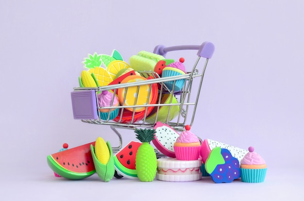 Buying diet food and fruit online. shopping cart Premium Photo