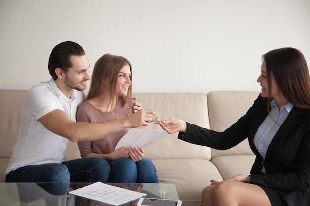Buying home. young happy couple getting keys of own apartment Free Photo