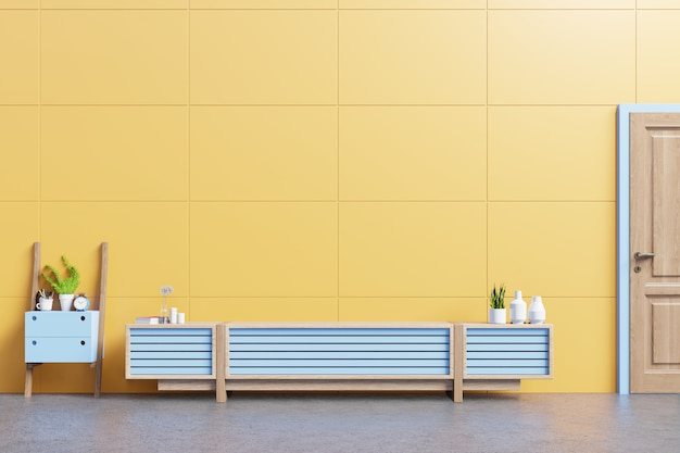 Cabinet mockup in modern living room with table,flower and plant on yellow wall. Premium Photo