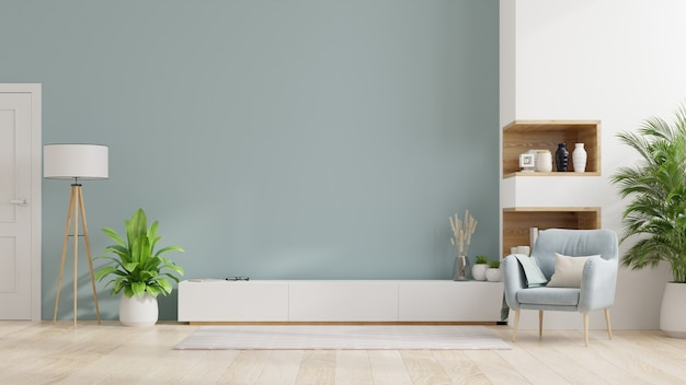 Cabinet tv in modern living room,interior of a bright living room with armchair on empty blue wall Premium Photo