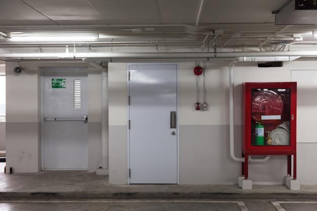 Cabinets and exit doorway in building Premium Photo
