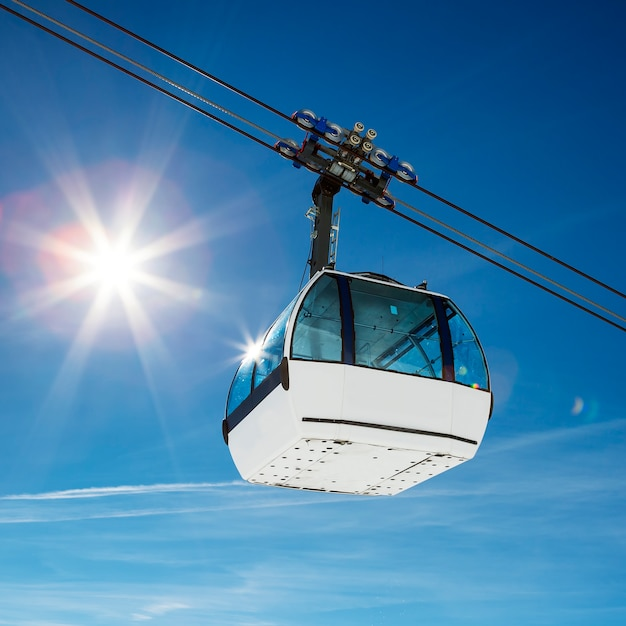 Cable car and sun in a mountain area Free Photo