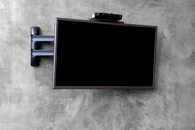 Cable Tv Set Hanging On The Cement Wall Photo Premium Download