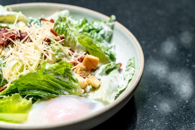 Caesar salad bowl with egg Premium Photo