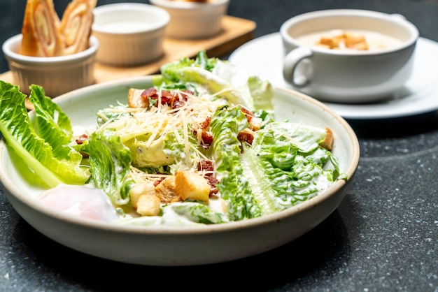 Caesar salad bowl with egg Premium Photo