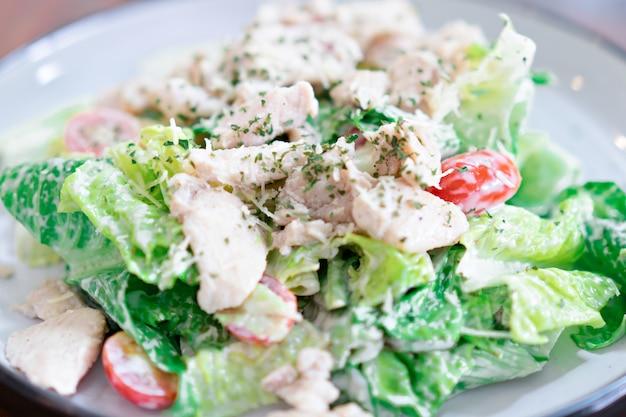 Caesar salad in a dish is a menu in the restaurant. Premium Photo