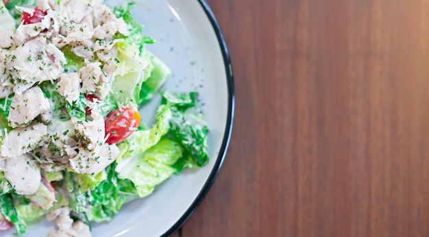 Caesar salad in a dish is a menu in the restaurant. Premium Photo
