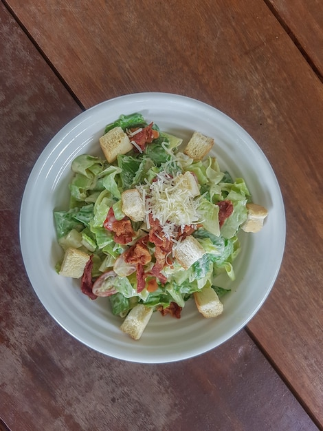 Caesar salad in a dish with copy space is a menu in the restaurant. Premium Photo