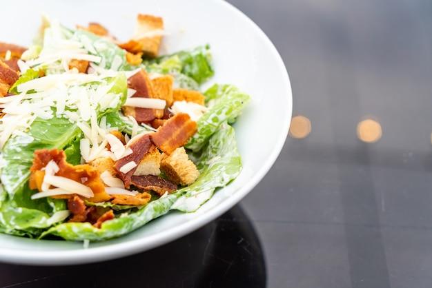 Caesar salad on white plate Premium Photo