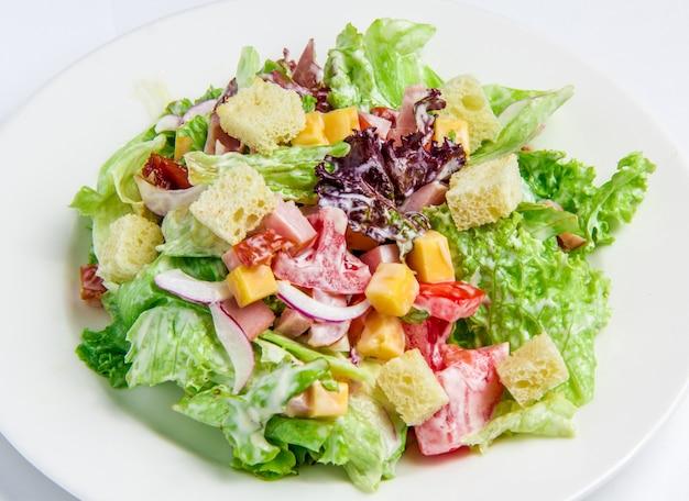 Caesar salad on white Free Photo
