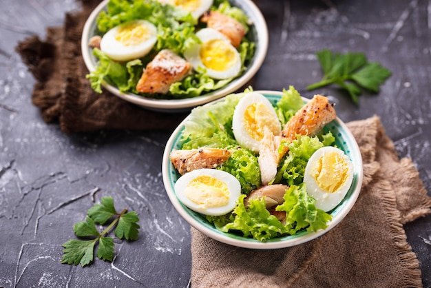 Caesar salad with eggs, chicken and parmesan Premium Photo